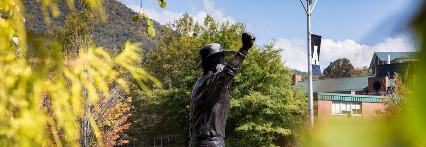 campus picture of the back of the Yosef statue